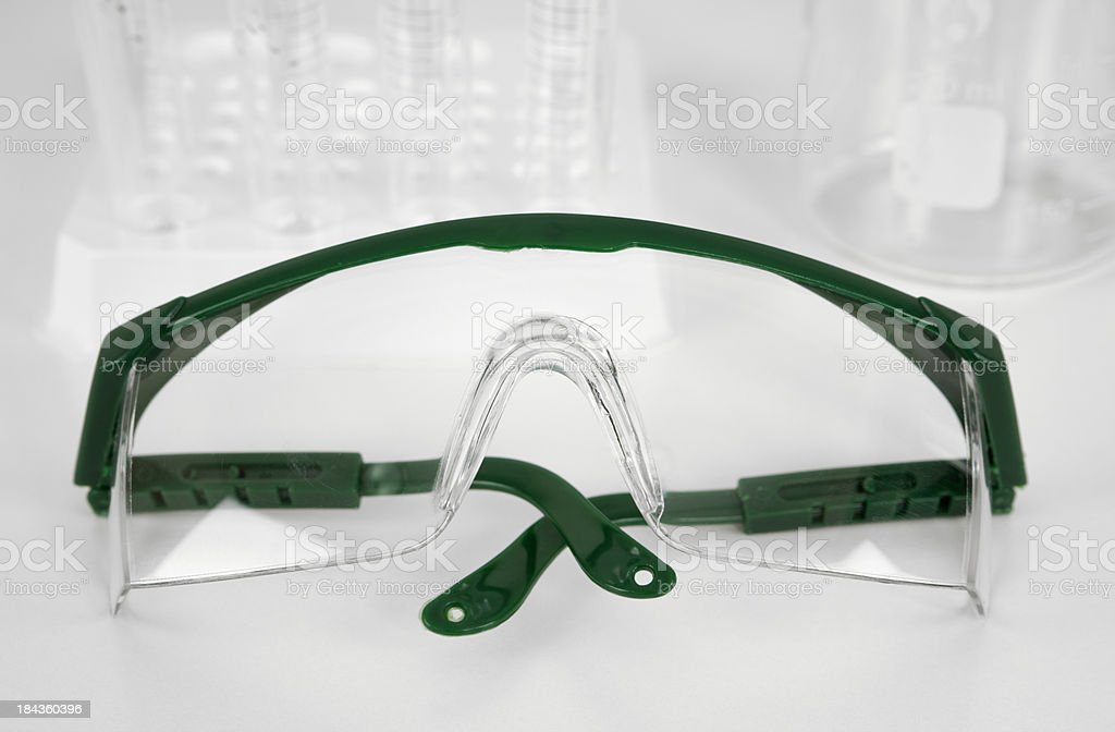 Safety Glasses with Lab Equipment royalty-free stock photo