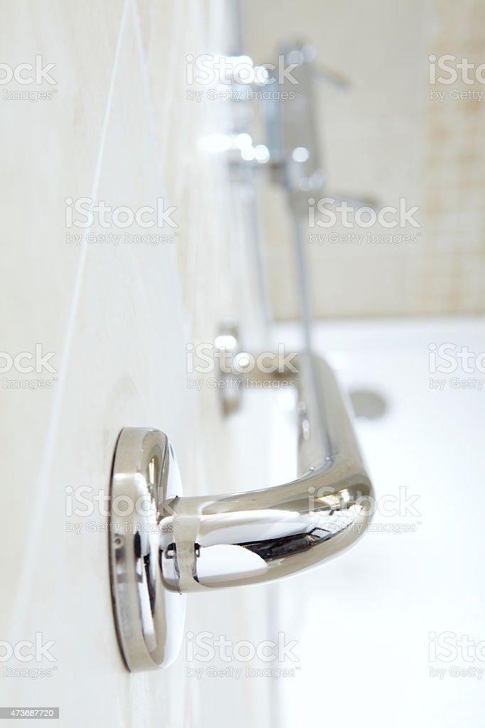 Safety grab bar in bathroom stock photo
