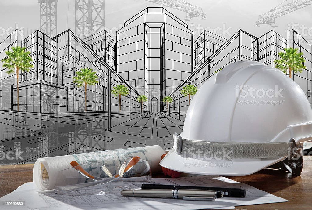 safety helmet and paper working plan of architecture stock photo