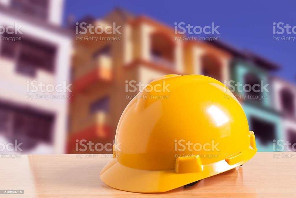 Safety helmet with construction site background stock photo