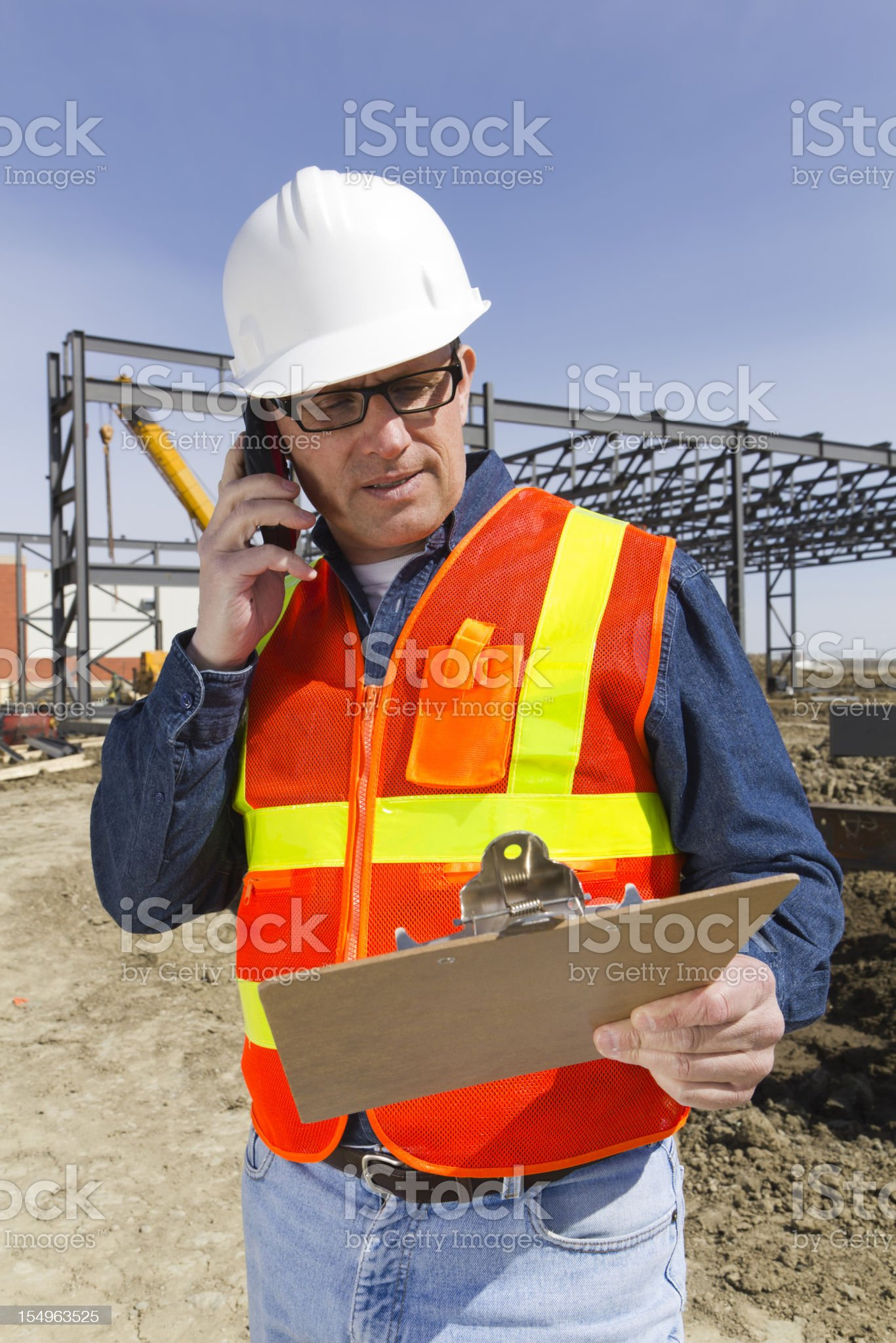 Safety Inspector on the Phone royalty-free stock photo