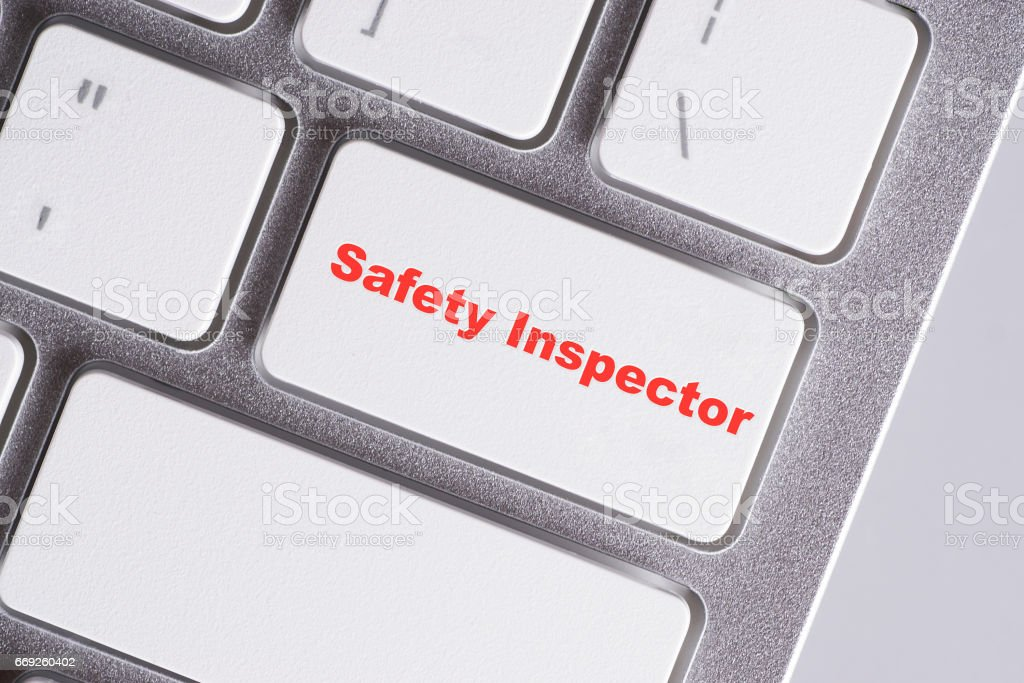 'Safety inspector' red words on white keyboard - online, education and business concept stock photo