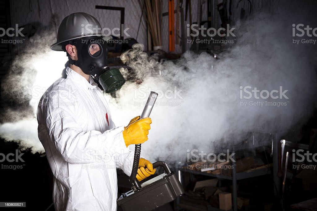 Safety inspector with Geiger counter testing emissions royalty-free stock photo