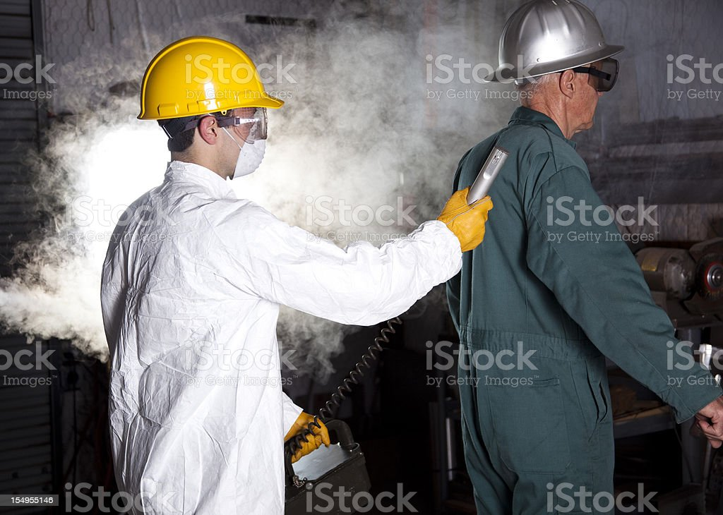 Safety inspector with Geiger counter testing worker stock photo