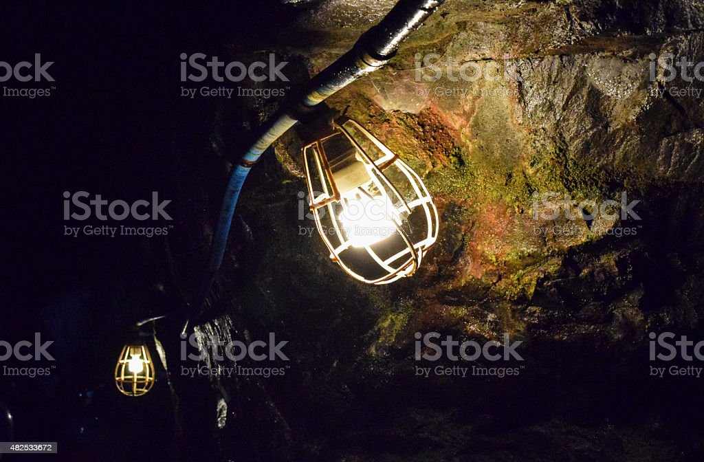 Safety Lights in Mine Tunnel stock photo