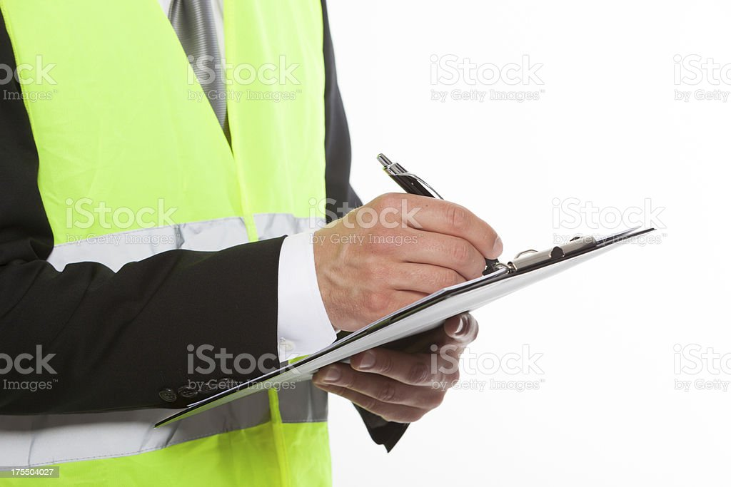 Safety man with note pad stock photo