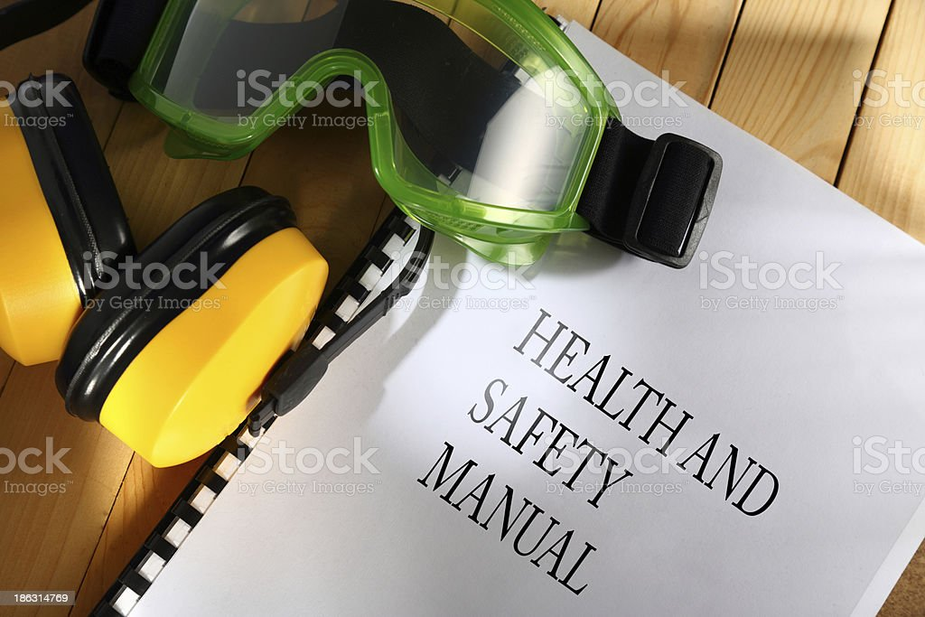 Safety manual with goggles and earphones stock photo
