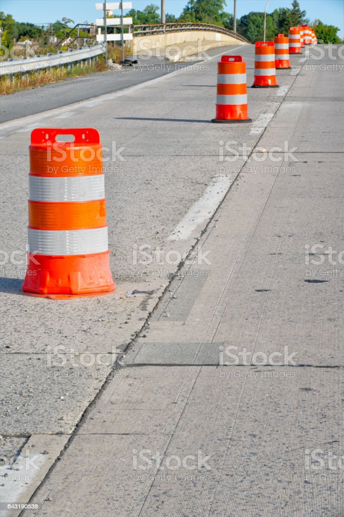 Safety orange Barrels in Highway Maintenance, Repair, Construction Zone stock photo
