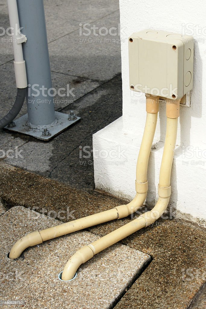 Safety outdoor electric connector box mounted on the wall stock photo