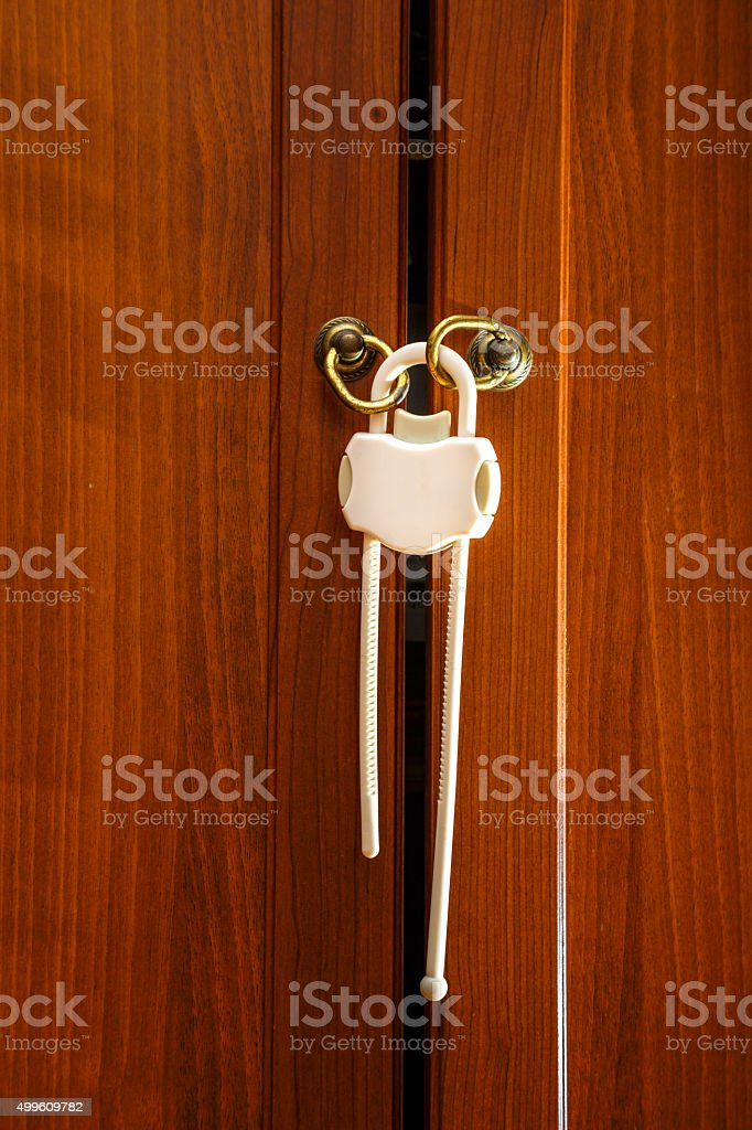 Safety plastic lock for kid protection stock photo