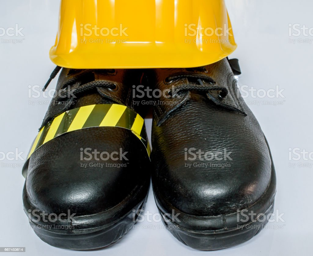 Industrial or Safety shoes and helmet with white glossy background.