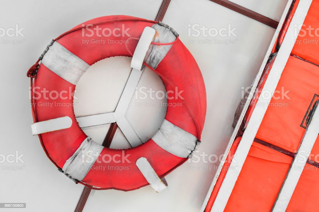 Safety torus and kick board for saving life on ferryboat stock photo