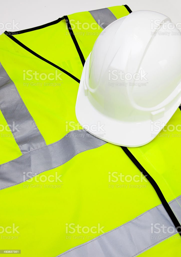 Safety vest and hard hat stock photo