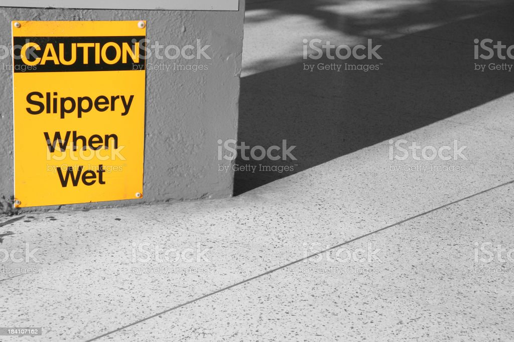 Safety Warning - Caution Slippery When Wet royalty-free stock photo