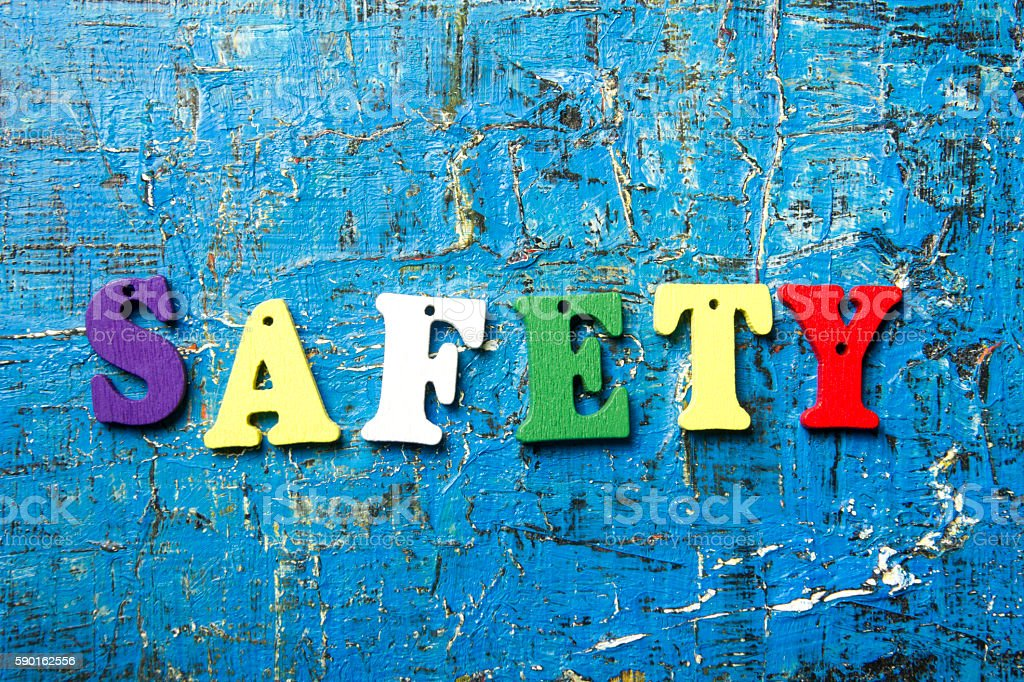 safety word written on wood abc letter at blue abstract stock photo