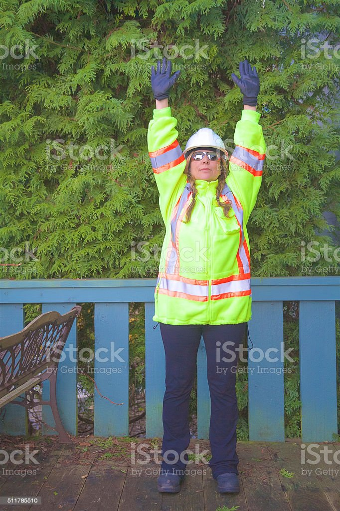 Safety Worker Stretching stock photo