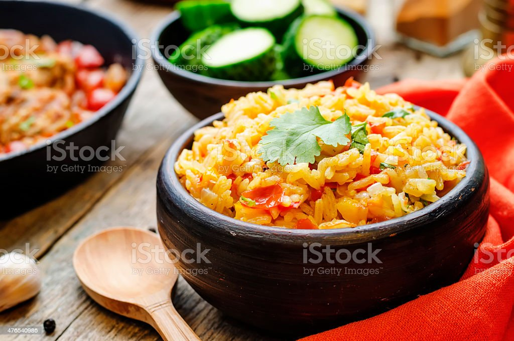 saffron rice with vegetables and cilantro stock photo