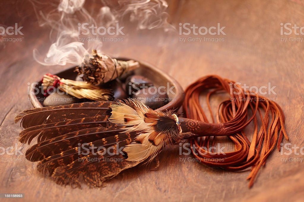 Sage stick and american indian feather stock photo