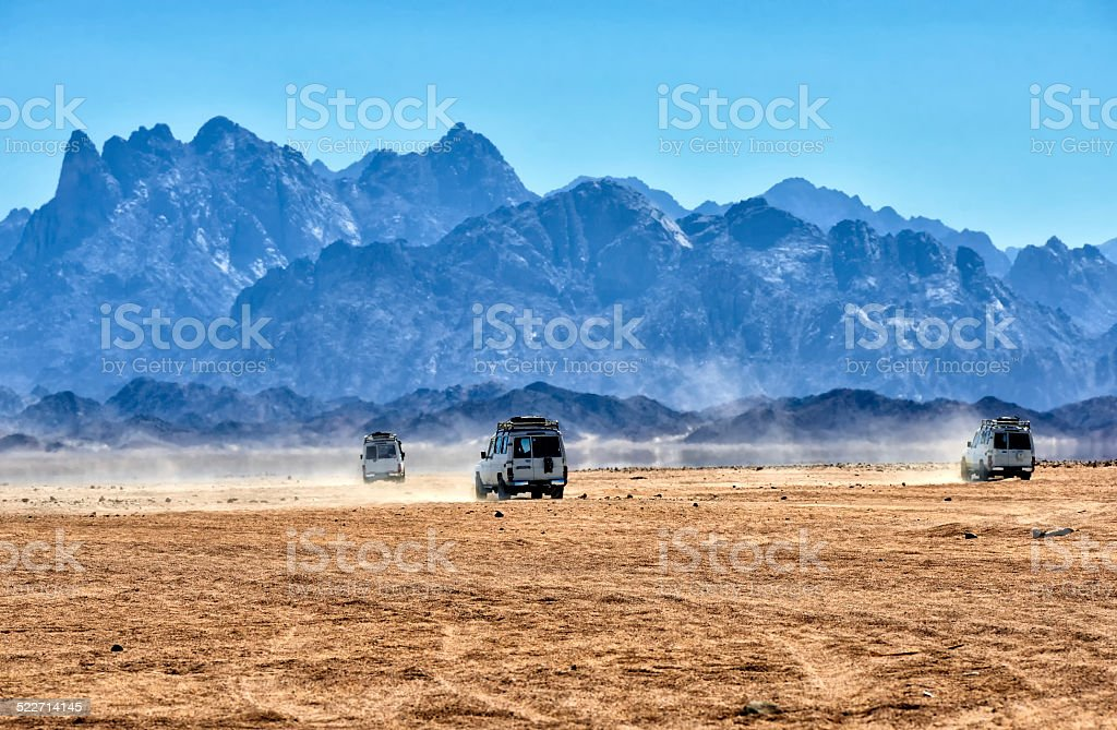Sahara desert with jeeps for safari. stock photo
