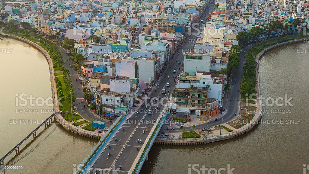 Saigon riverside with the Nhieu Loc canal and houses stock photo