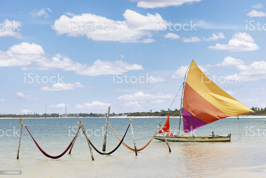 sail boat and hammocks at Jericoacoara, Brazil stock photo