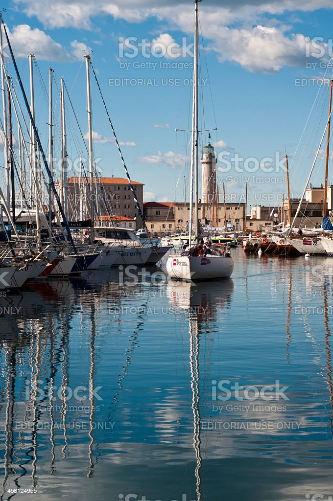 Sail boat entering the harbor in Trieste, Italy royalty-free stock photo