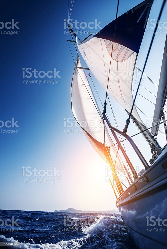 Sail boat in action stock photo