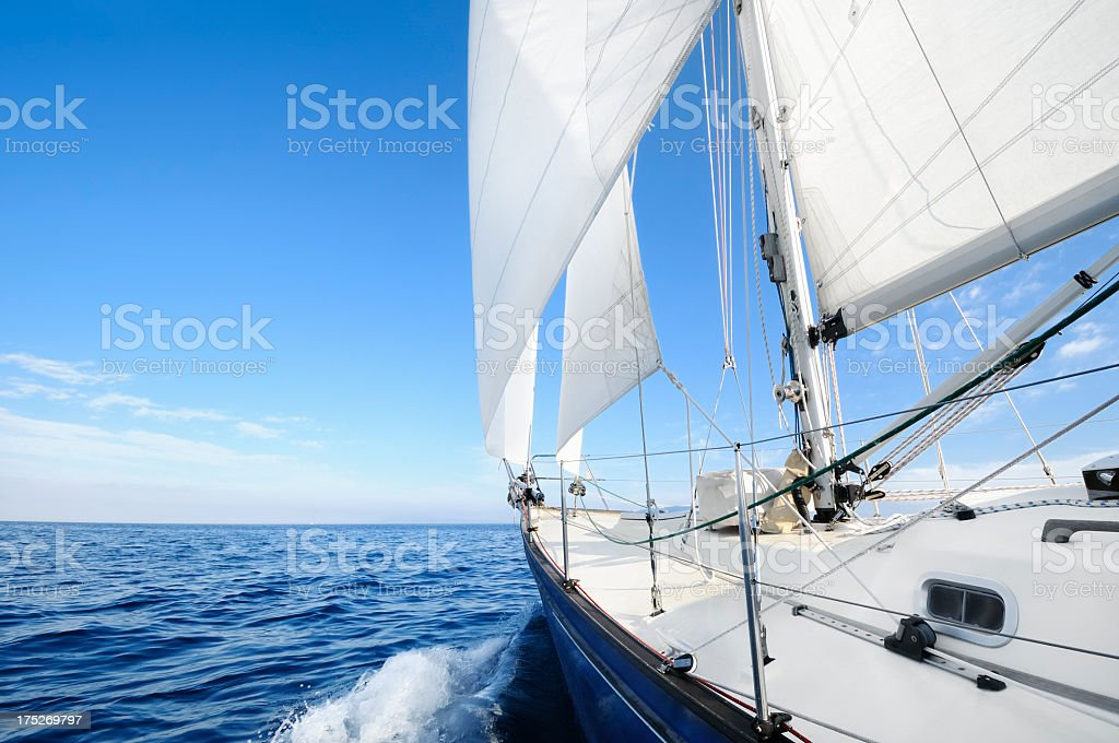 Sail boat in the middle of the ocean stock photo