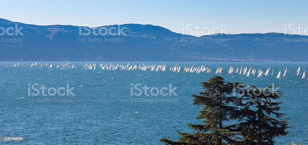Sail boat on a lake with mountains as background stock photo