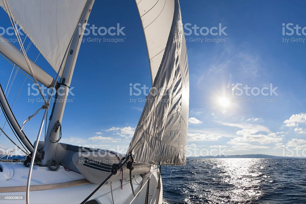 Sail boat sailing in the sea on a sunny day stock photo