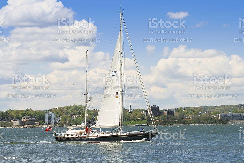 Sail Boat under English flag entering New York Harbor. royalty-free stock photo