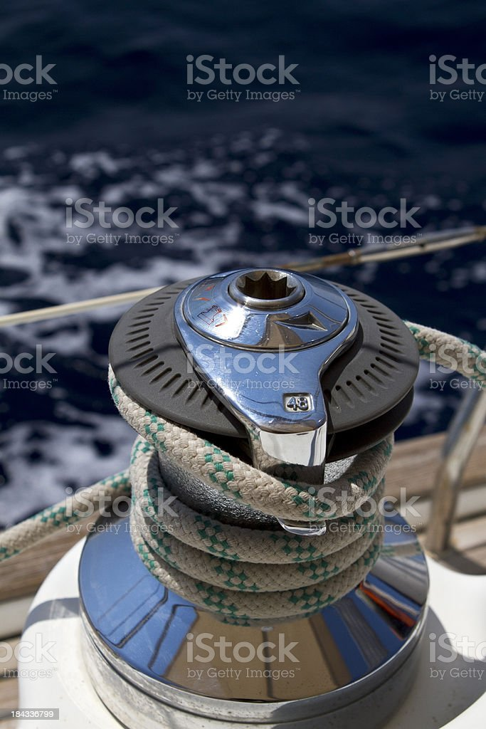 Sail boat winch with tight rope royalty-free stock photo
