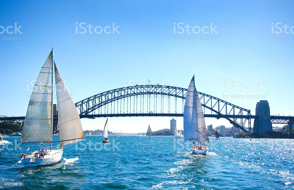 Sail Boating at Sydney Harbor Bridge, Australia stock photo