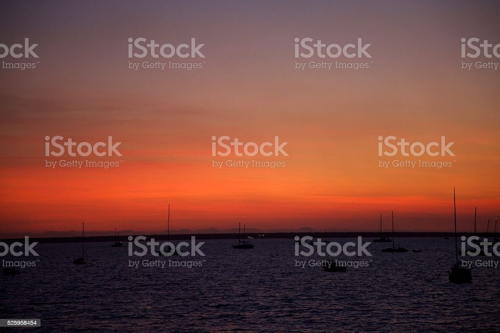 Sail boats at sunset in the Harbour, Darwin, Australia stock photo
