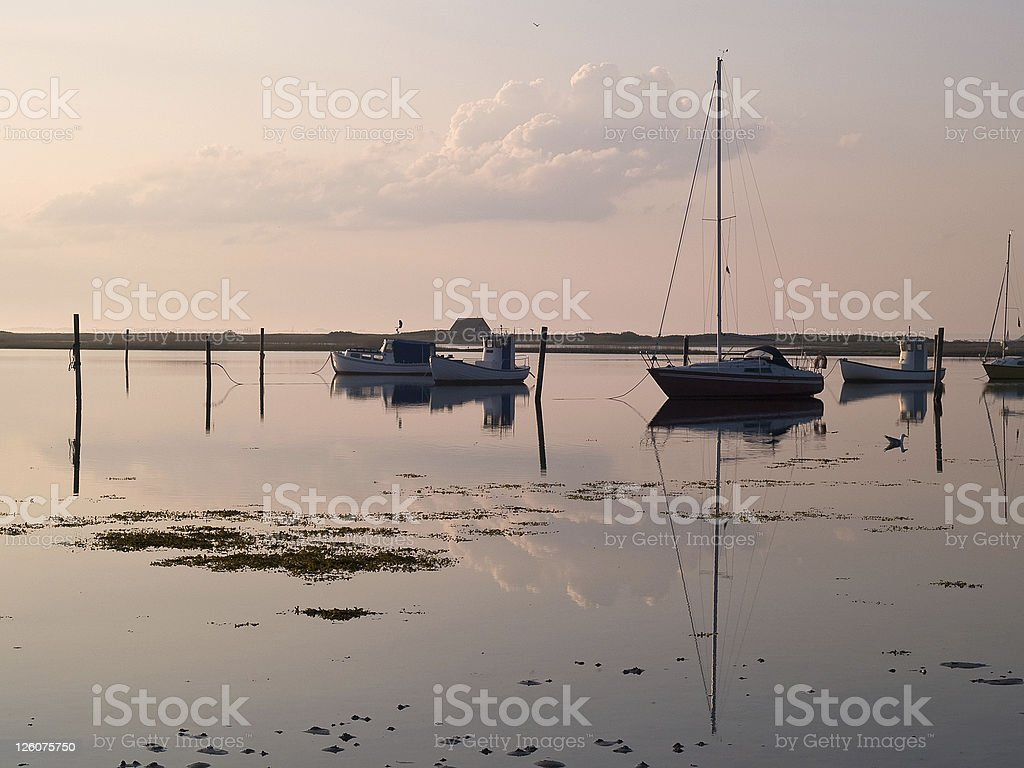 Sail boats reflected in the ocean royalty-free stock photo