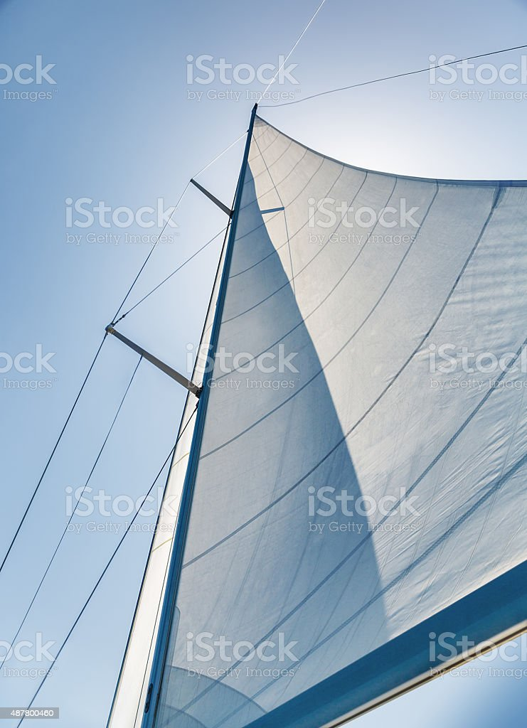 Sail on sky background stock photo