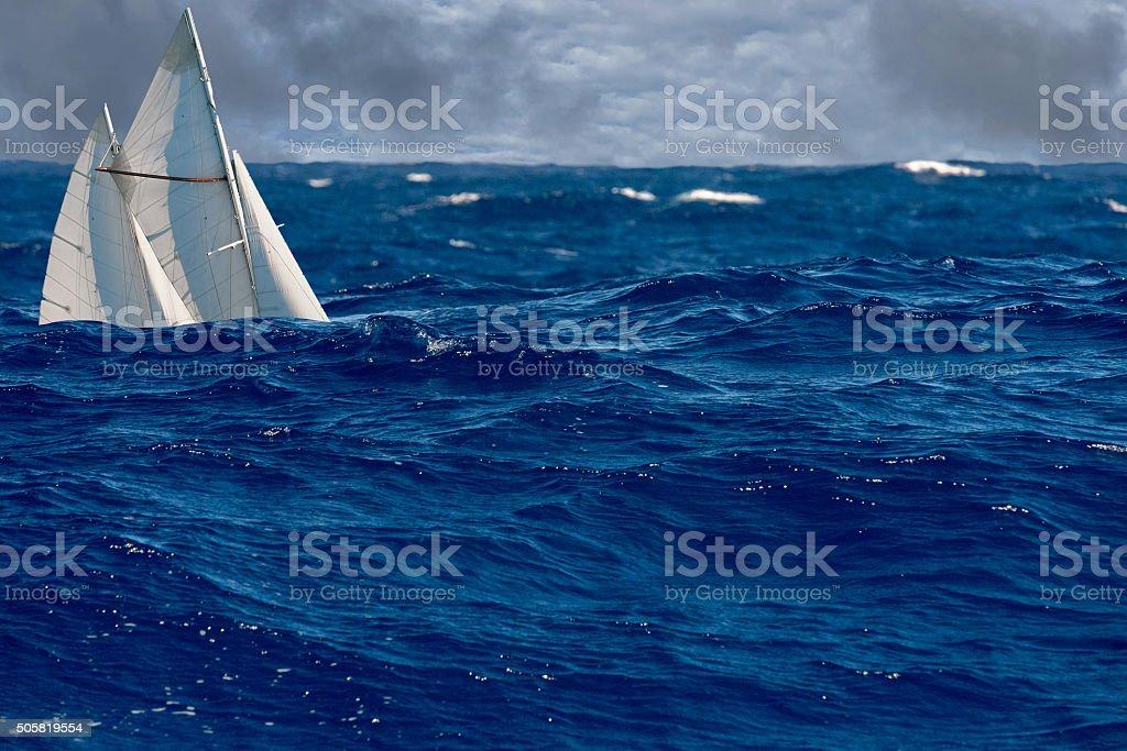 sail ship in big waves stock photo