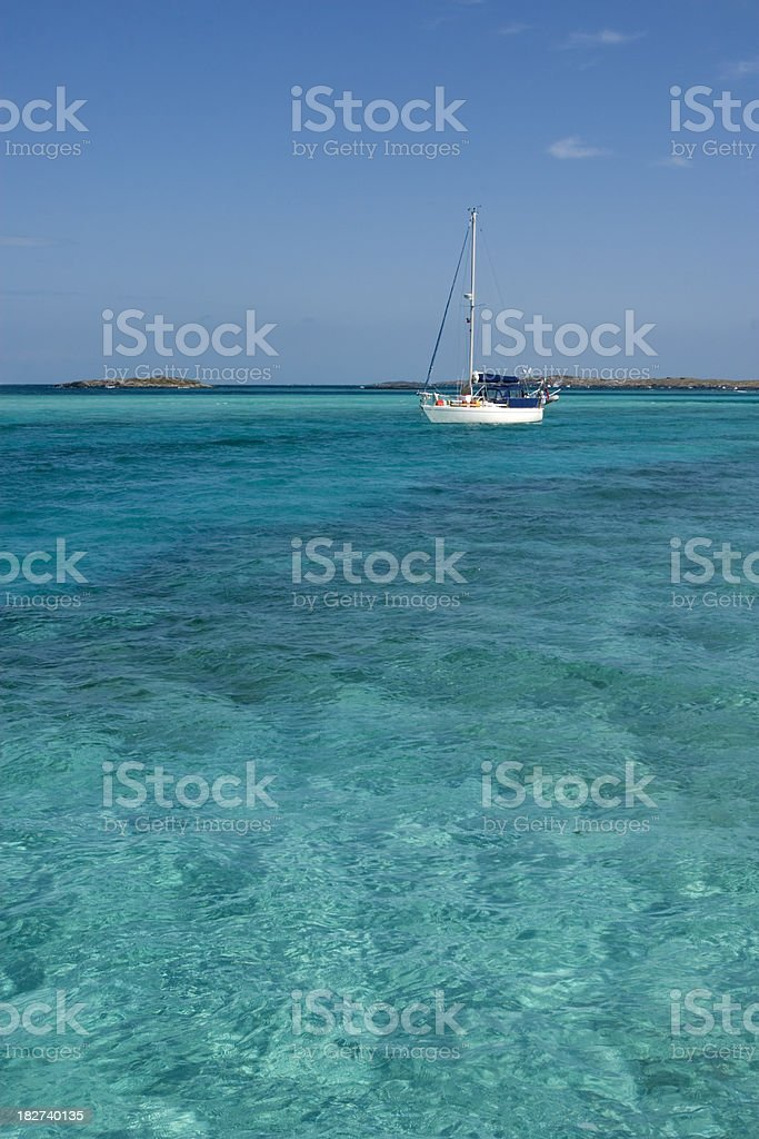 Sailboat anchor in a cove royalty-free stock photo