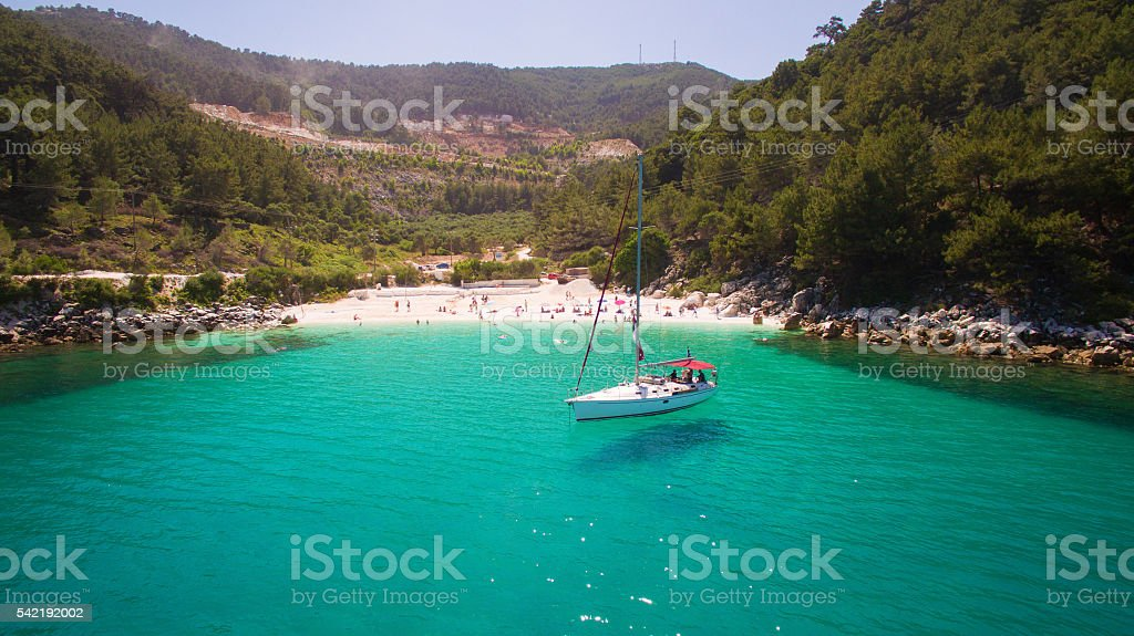 Sailboat anchored near Marble beach on Thassos island, Greece stock photo
