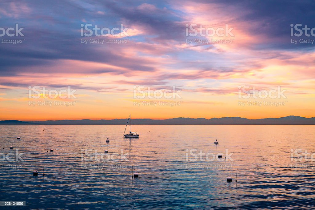 Sailboat Anchored Off Avalon At Sunset, Mainland California In Background royalty-free stock photo