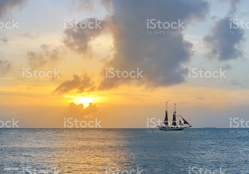 sailboat and a beautiful sunset stock photo