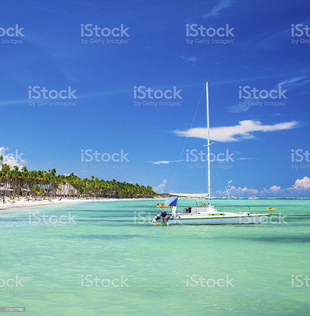Sailboat and caribbean beach royalty-free stock photo