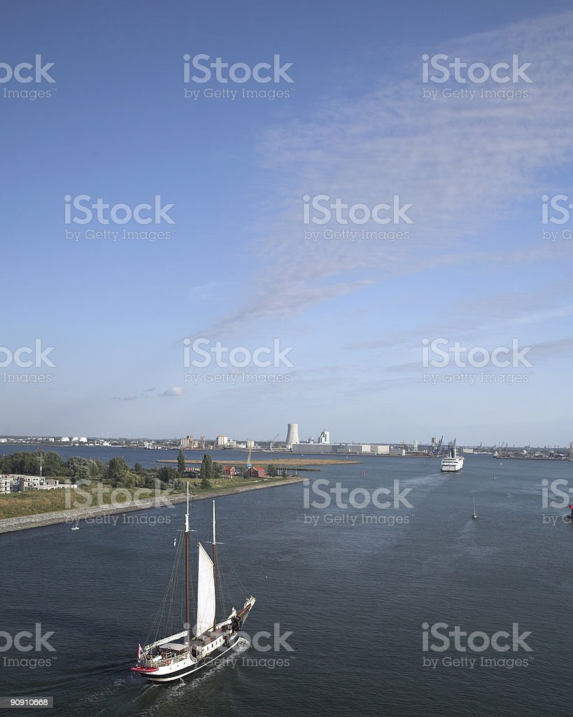 Sailboat and Ferry Entering Harbour near Wernemunde stock photo