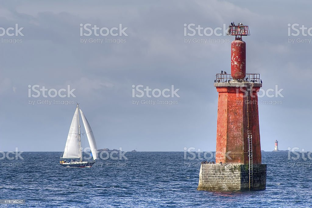 sailboat and lighthouse royalty-free stock photo