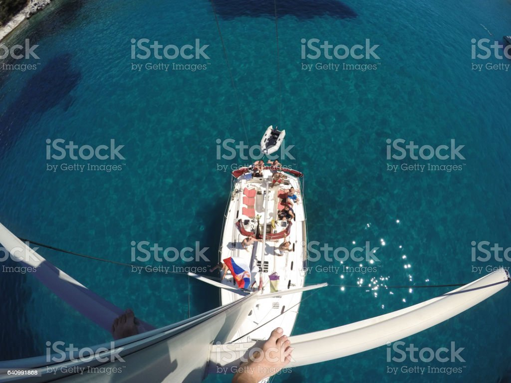 Sailboat and ship crew seen from top of the mast stock photo