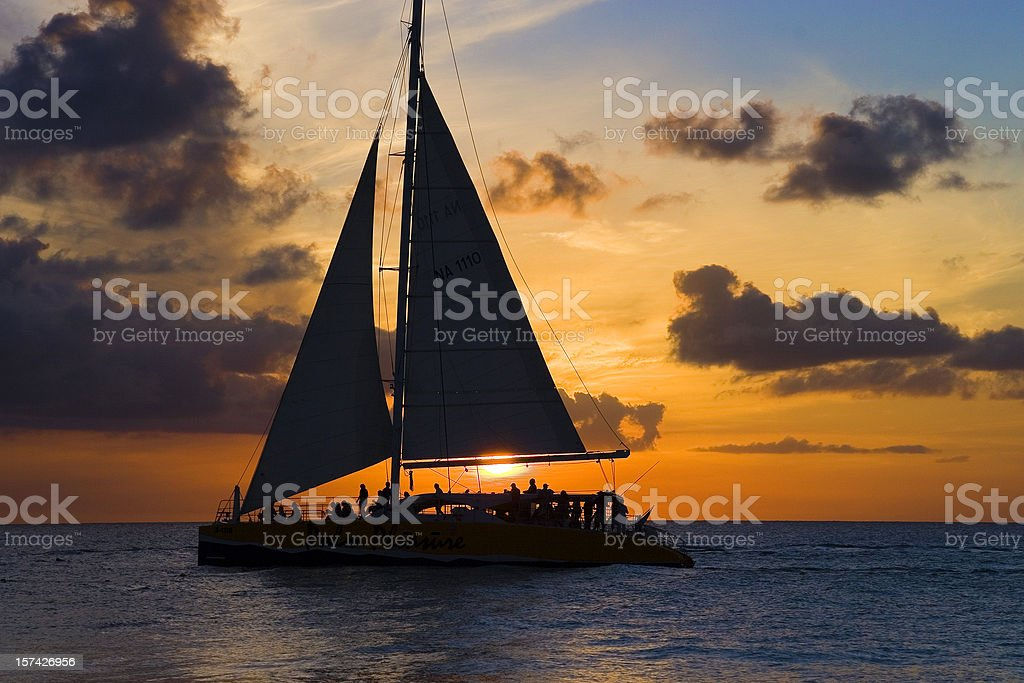 Sailboat and sunset stock photo