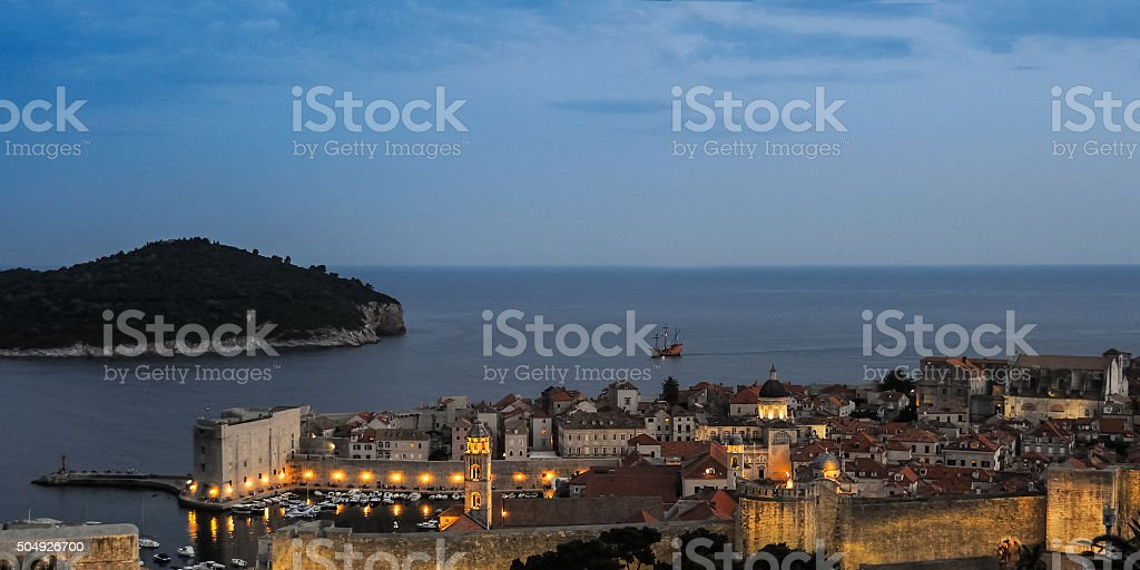 Sailboat at dawn in front of Dubrovnik stock photo