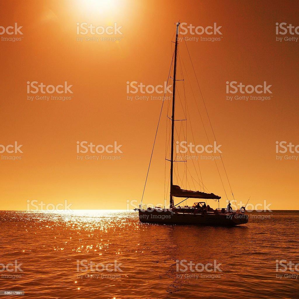 Sailboat at dusk stock photo
