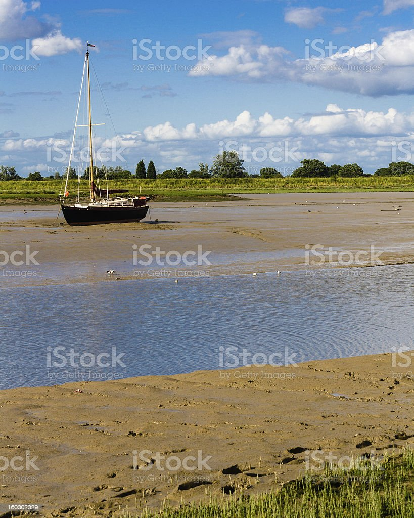 sailboat at low tide stock photo