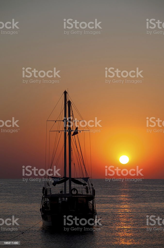 Sailboat at Sunset in mediterranean sea stock photo